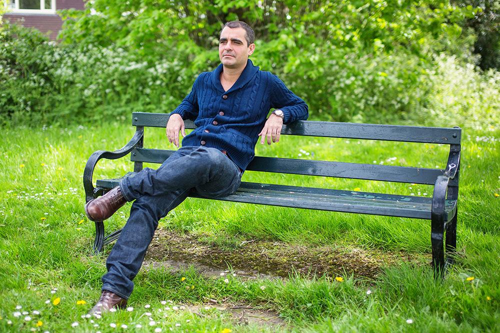 05_man-on-bench-green-portrait
