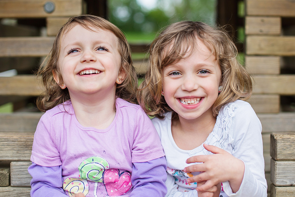 siblings sisters laughing together kids