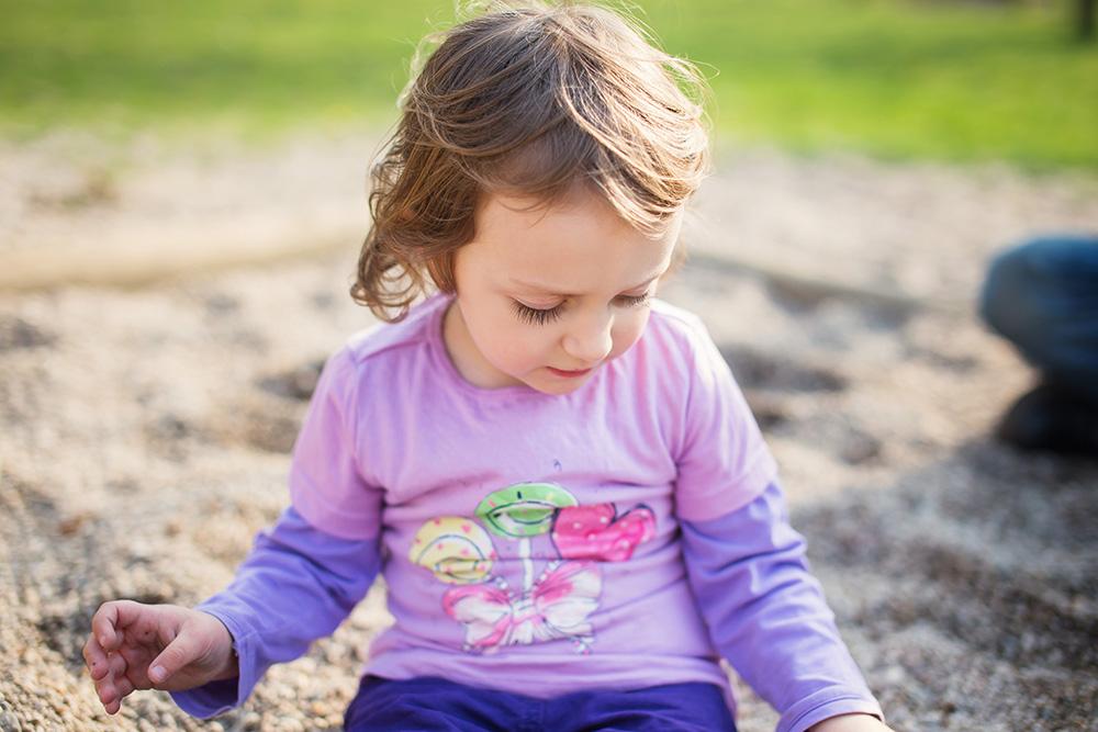 Lea on playground alone sandbox