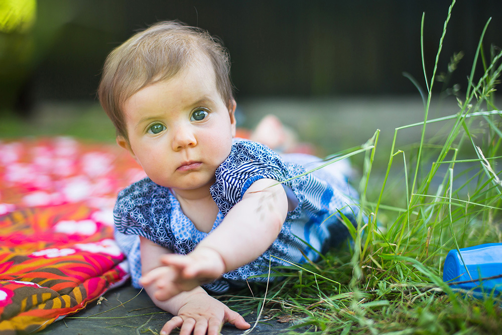 16a_baby-girl-playing-in-grass