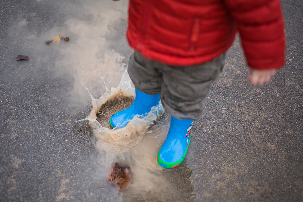 toddler in a puddle