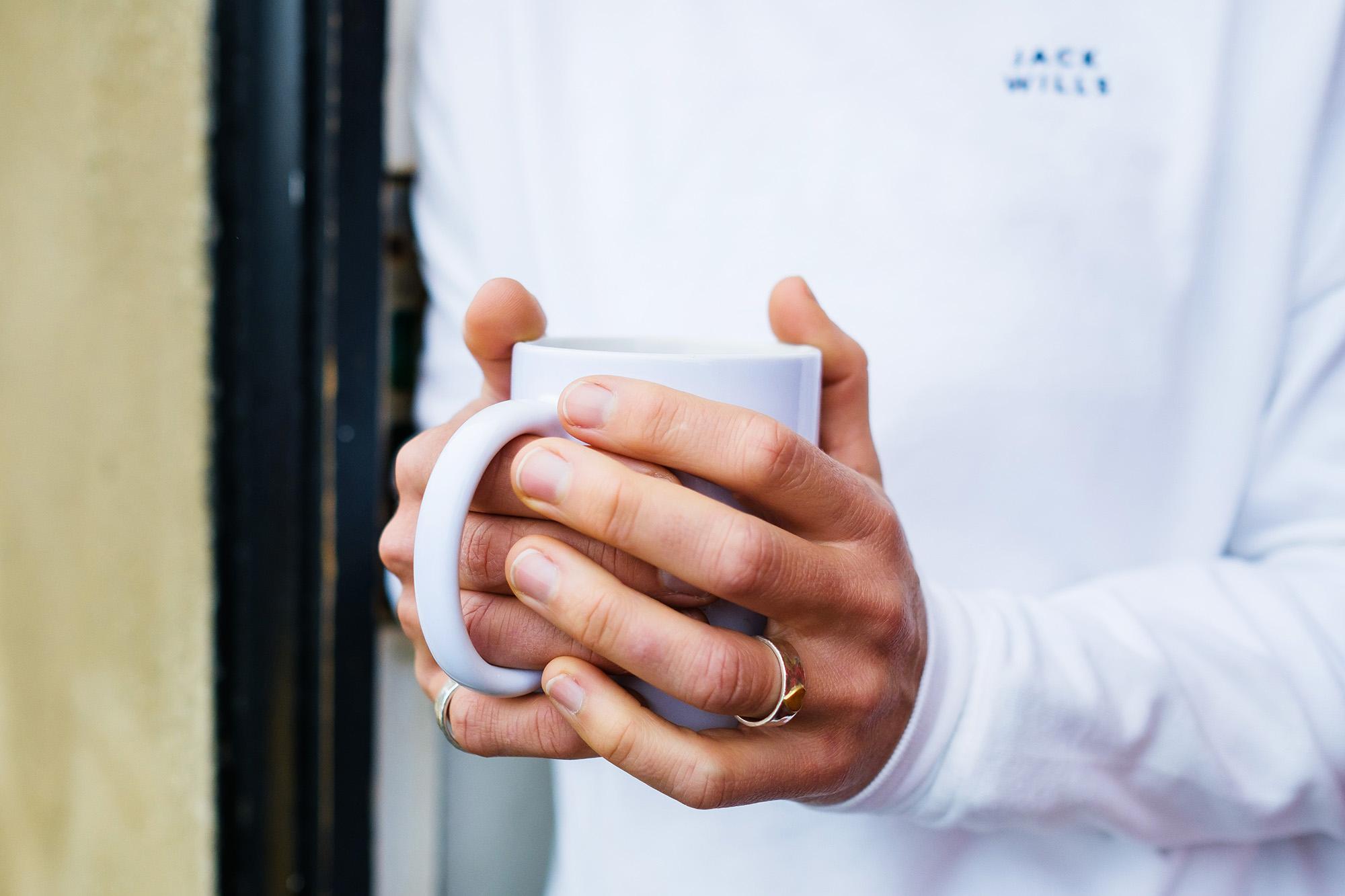 close up hands tea
