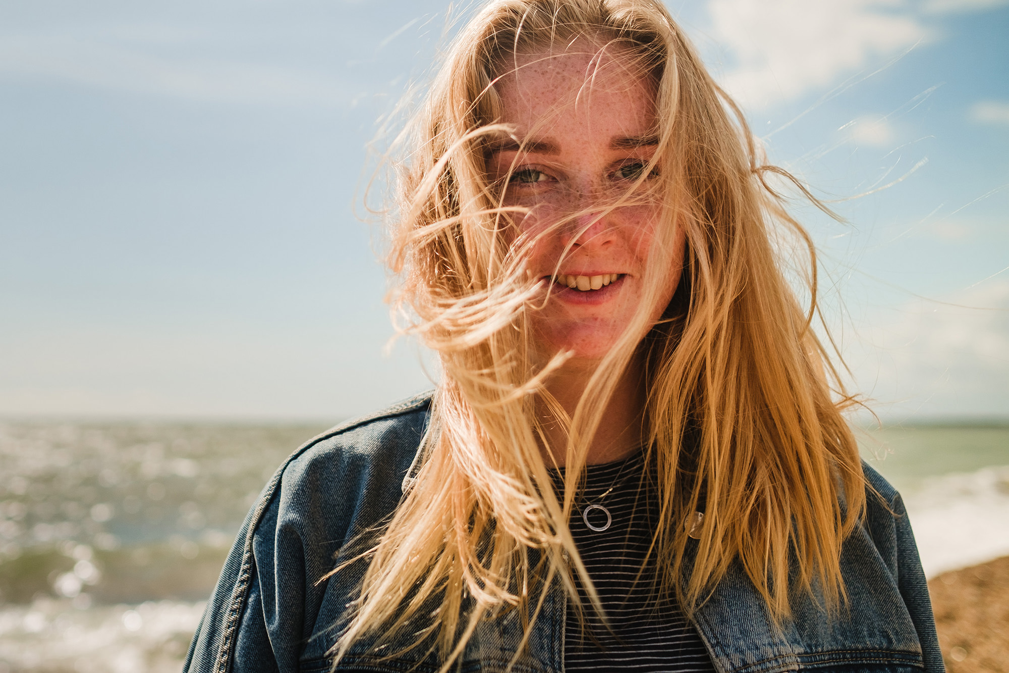 beach hair wild windy woman