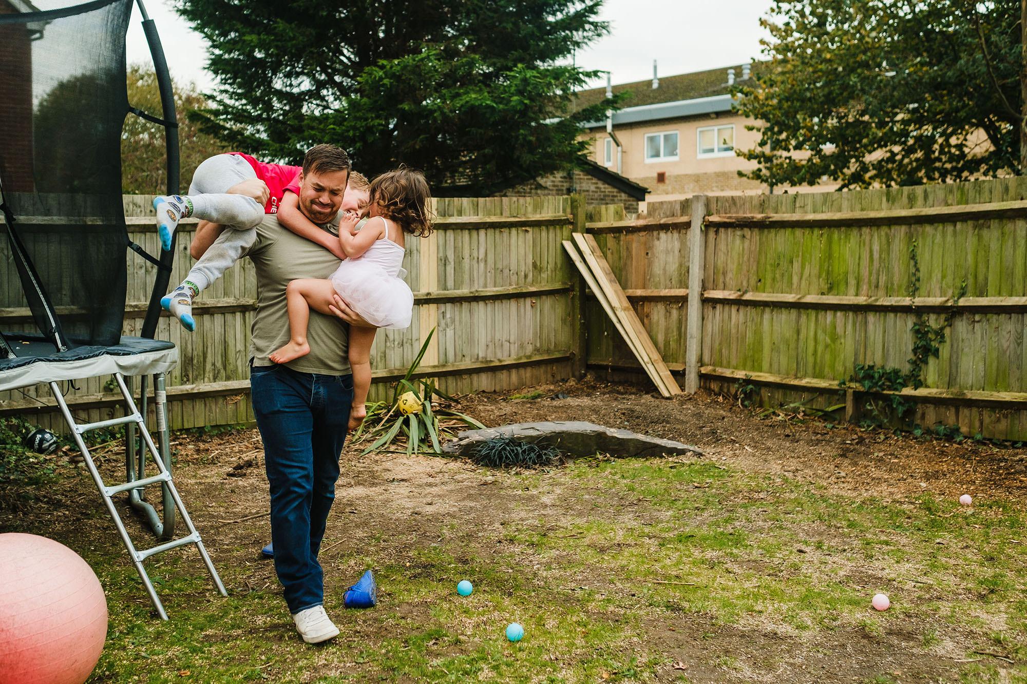 dad with kids in garden