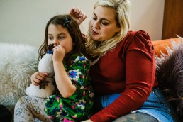 mummy and toddler girl on couch, documentary family photos south of England