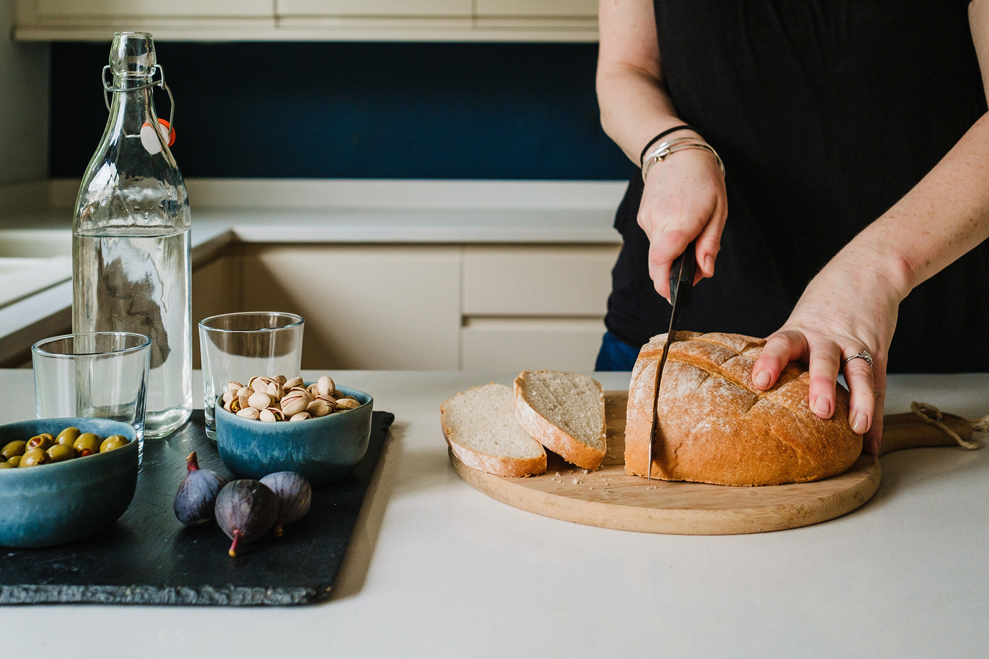 cutting bread in newly designed kitchen