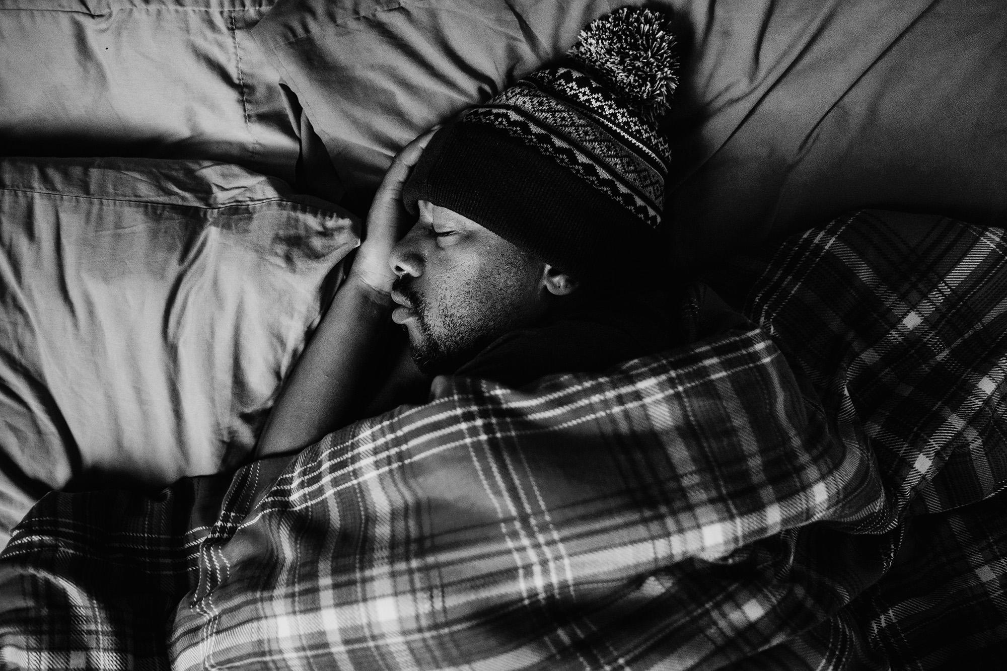 man in bed sleeping