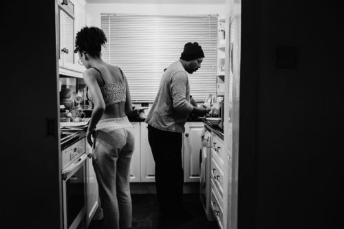 dad and daughter cooking dinner black and white