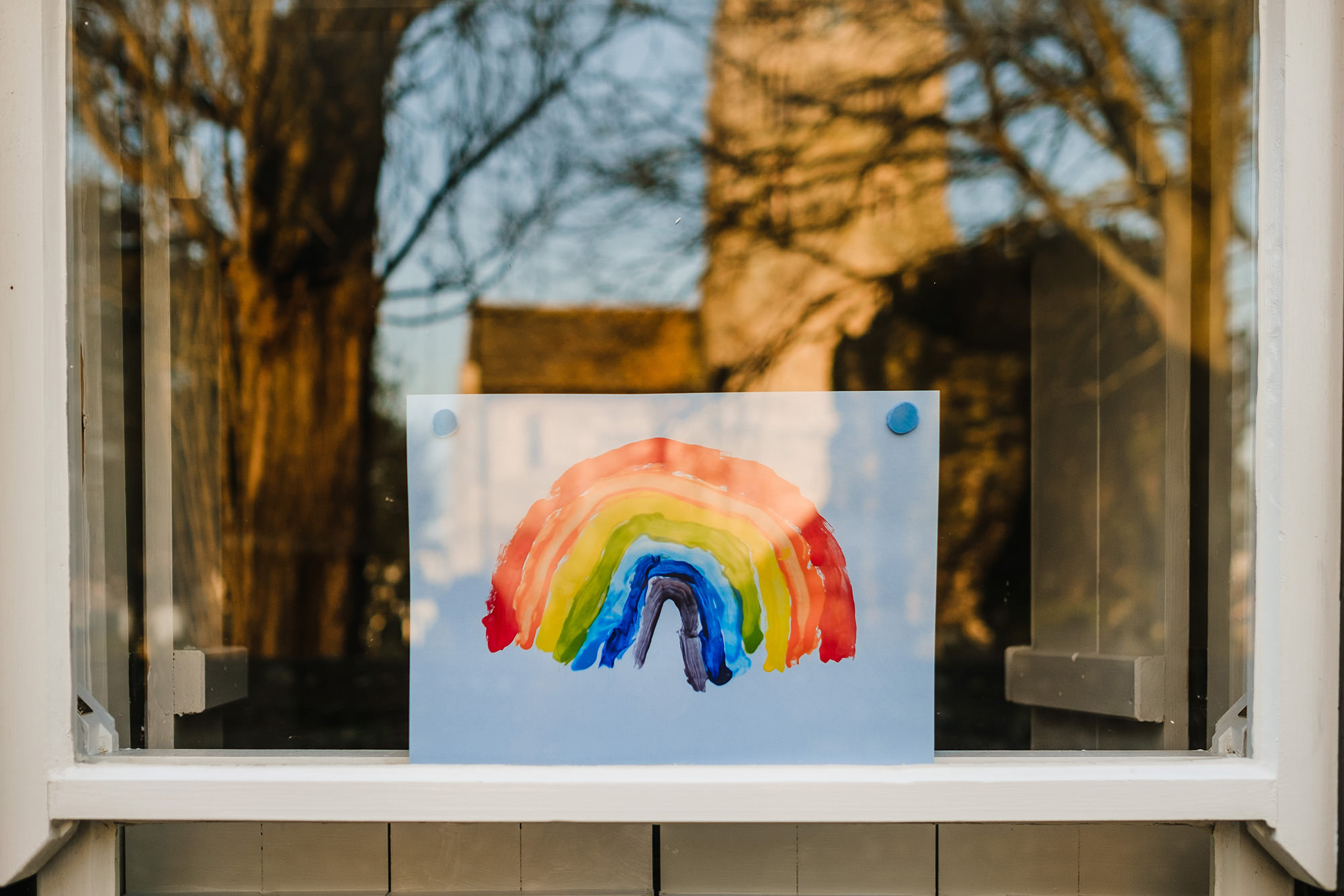 rainbow picture in window social distancing