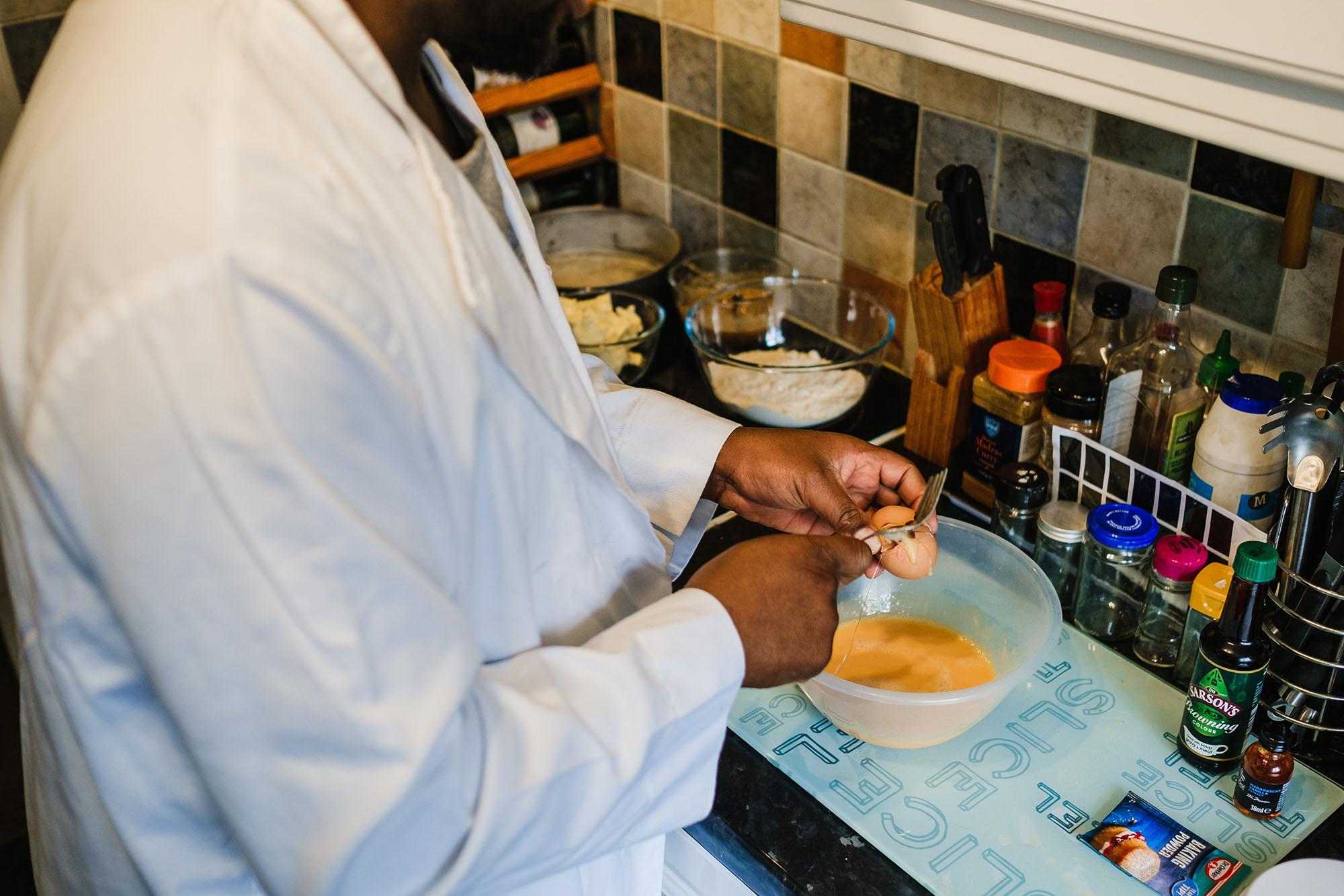 making rum cake cracking an egg