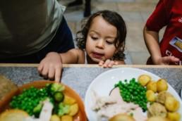 toddler grabbing dinner