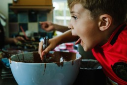 lifestyle vs documentary family photography - wild child eating cake batter