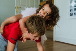 brother and sister playing - documentary family photography