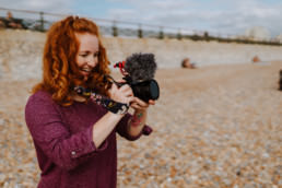 Anja filming on the beach Hove