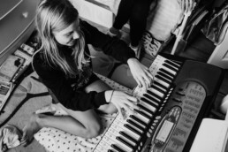 playing piano teenage girl