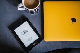 macbook and kindle and coffee