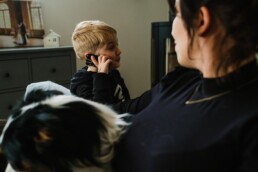 boy on phone to dad
