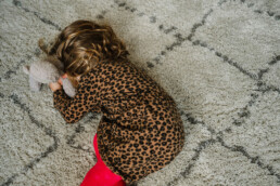 toddler on the floor hiding