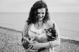 portrait of a woman with her dog on the beach