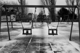 documentary family photographer empty swing set